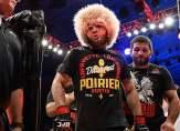 مصارع روسي يبيع قميص خصمه بـ100 ألف دولار ويتبرع بالمبلغ!