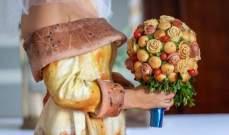 بالصور: عرض خاص بالأعراس... كعكة زفاف وباقة من البيتزا!