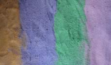 إيطاليا تغرم سائحاً 1200 دولار بعد استيلائه على كمية قليلة من الرمال الملونة