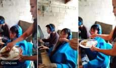 أم تطعم ابنها أثناء مواصلته للعب الفيديو لمدة 48 ساعة في مقهى للإنترنت