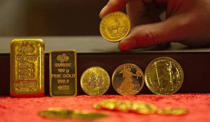 عقود الذهب تتراجع بنسبة 0.41 % إلى 1726.9 دولاراً للأوقية