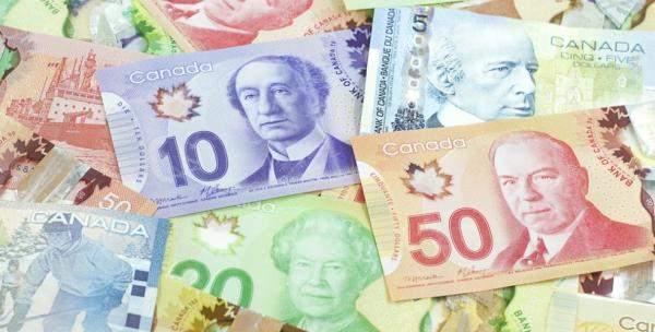 الدولار الكندي يتراجع هامشياً رغم صدور بيانات اقتصادية إيجابية