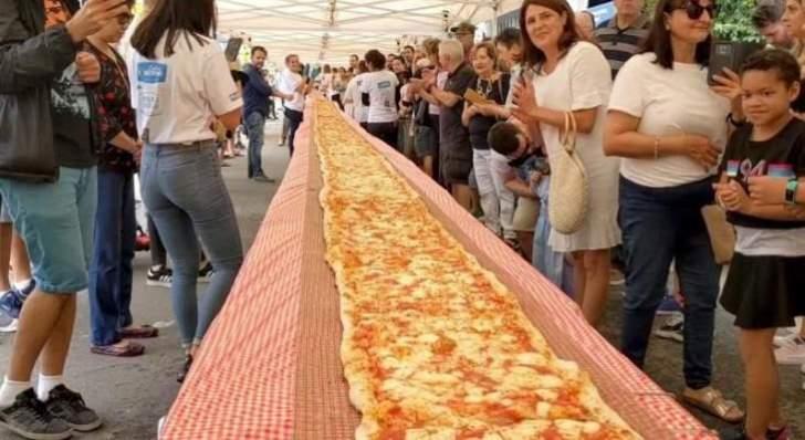 أستراليا.. بيتزا بطول 103 أمتار لجمع المال من أجل فرق الإطفاء