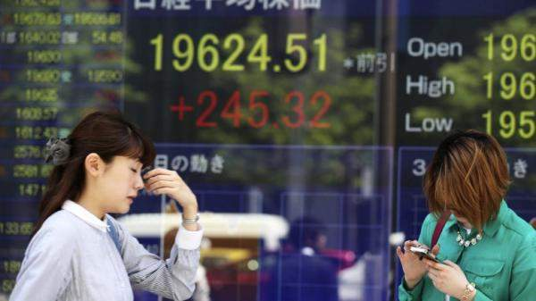 أسواق آسيا تتداول بمستوى أعلى بعد إعلان حول اليوان الصيني