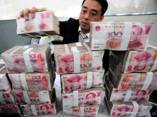 المركزي الصيني يحدد السعر المرجعي لليوان عند 7.0326